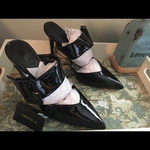 Pointed toe open Back stilettos